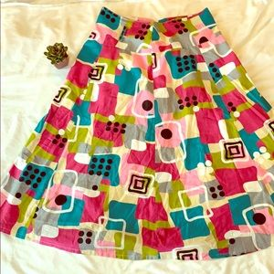 A line Midi skirt. 30 inches long. Zips in back.